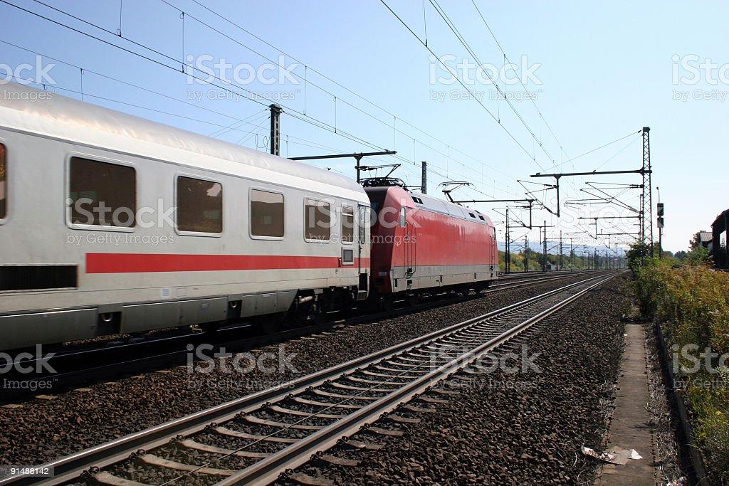 IC Lokomotive und fahrender Zug - Deutsche Bundesbahn royalty-free stock photo