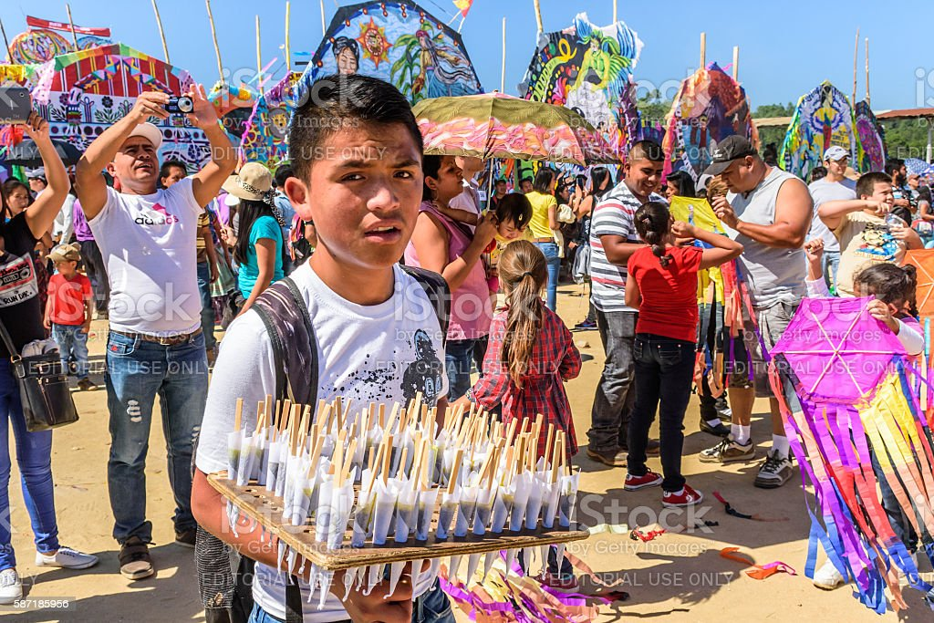 Lollipop vendor & visitors, Giant kite festival, All Saints' Day, Guatemala stock photo