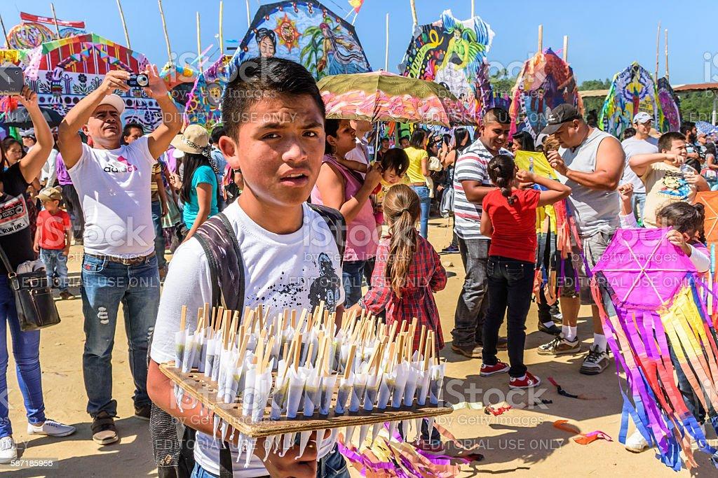 Lollipop vendor & visitors, Giant kite festival, All Saints' Day, Guatemala stock photo