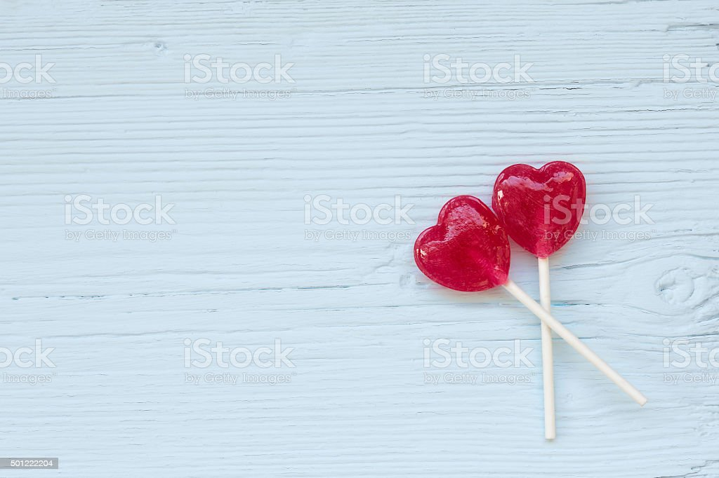 Lolly pop hearts  on a wooden background stock photo