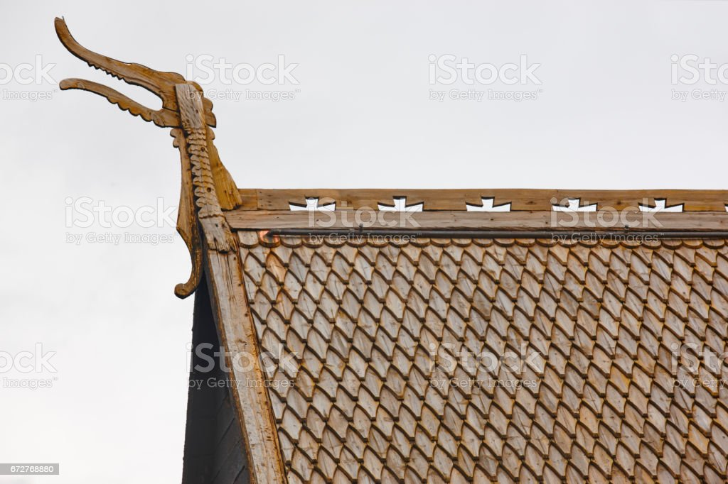 Lom medieval stave church roof detail. Viking symbol. Norway tourism stock photo