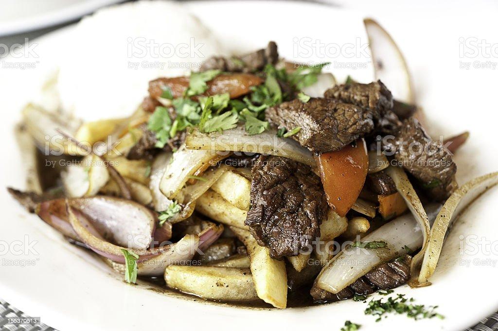 Lomo Saltado (Peruvian Stir-Fried Beef) stock photo