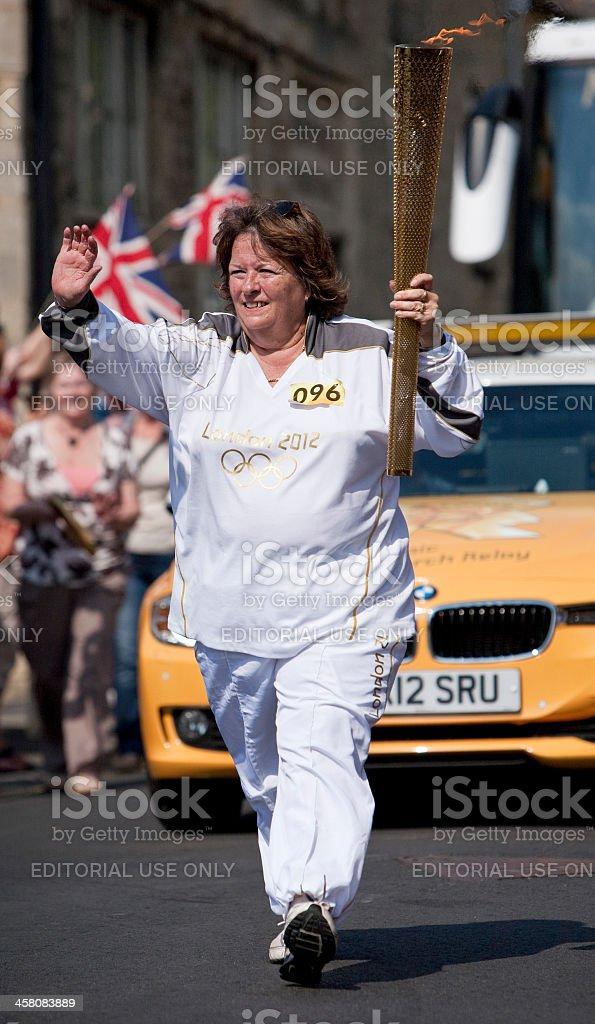 London 2012 Olympic Flame Taken through an English town stock photo
