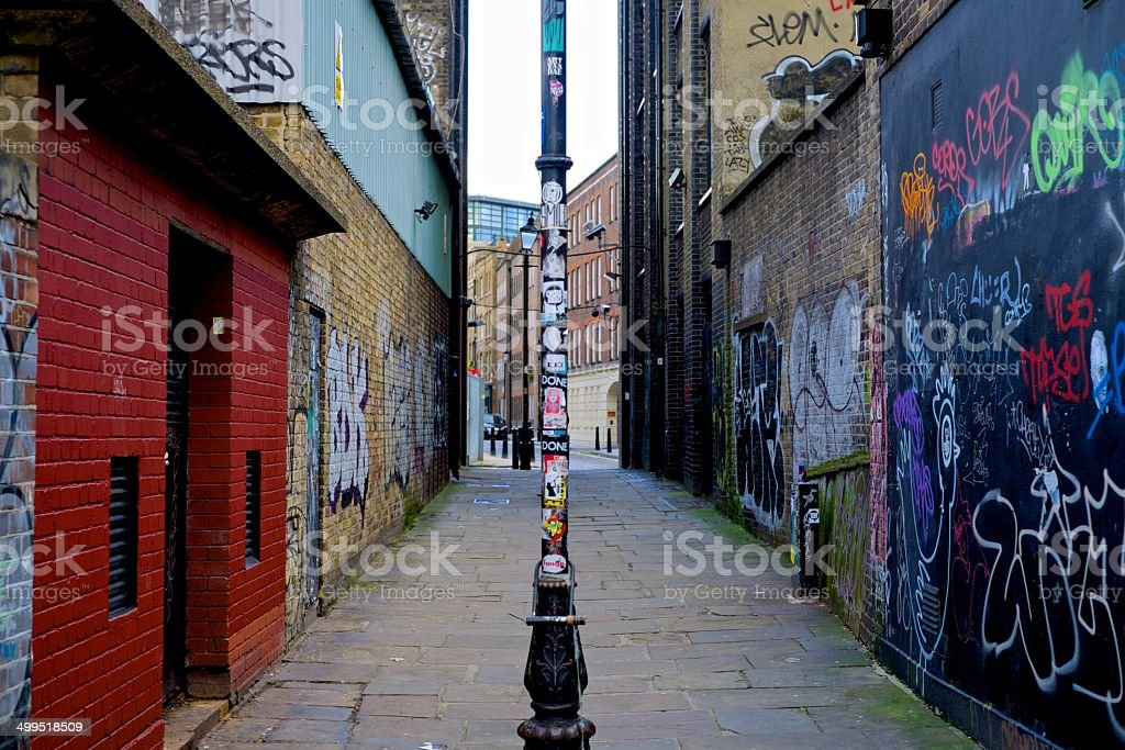 London alleyway covered in Grafitti stock photo