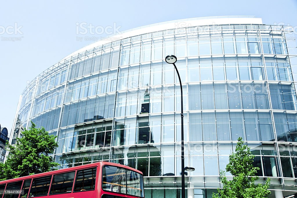 london architecture: mondern reflective building facade with double decker bus royalty-free stock photo
