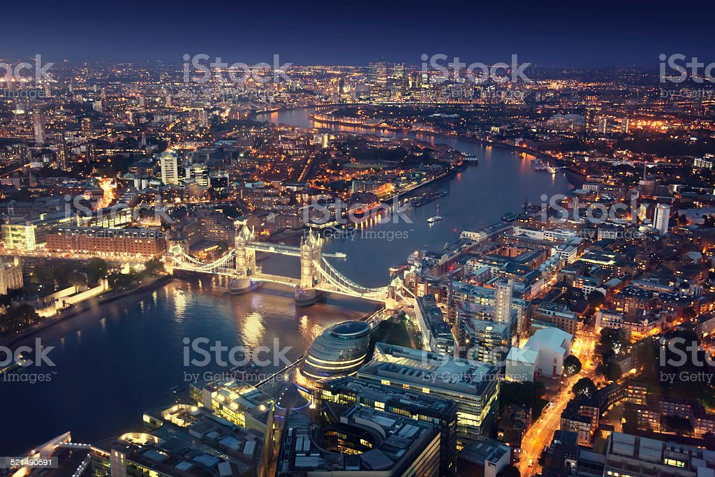 London at night with urban architectures and Tower Bridge stock photo