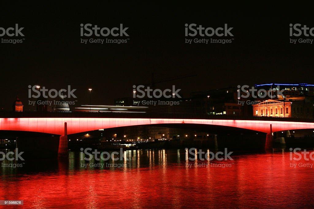 London Bridge At Night With Fluorescent Red Light stock photo