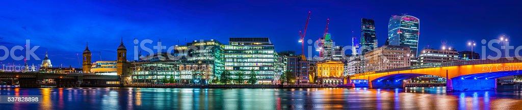 London Bridge City skyscrapers illuminated at night River Thames panorama stock photo