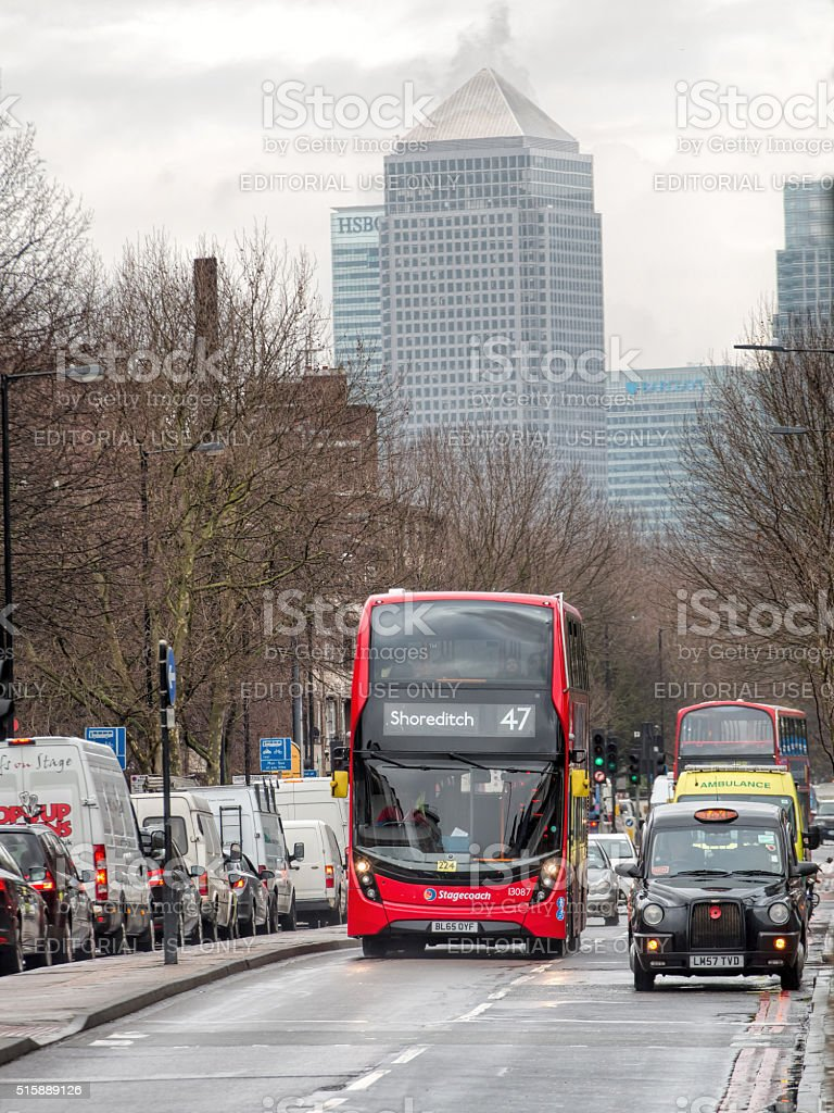 London Bus And Black Cab Rush Hour. Canary Wharf Background stock photo