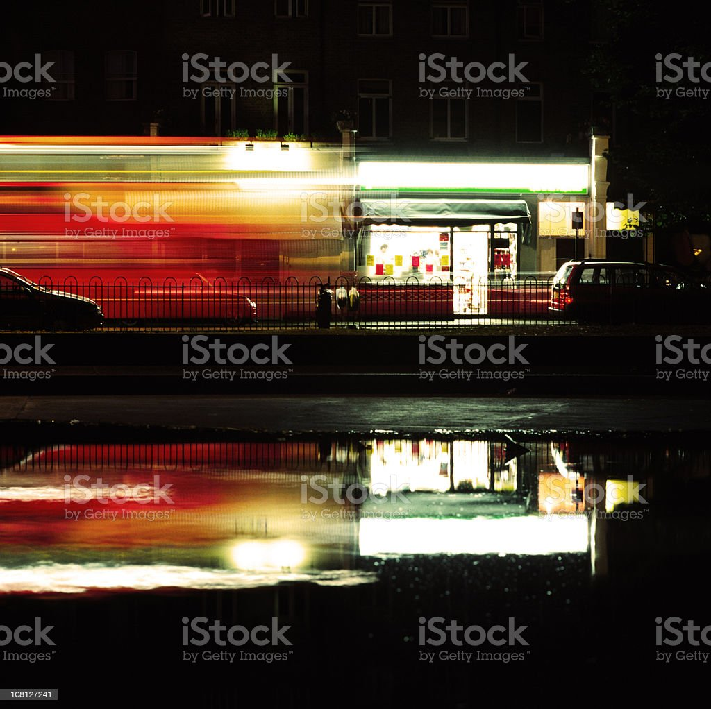 London Bus at Night Reflection in Puddle, Motion Blur royalty-free stock photo
