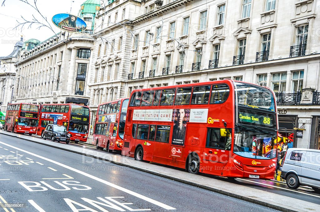 London bus in motion in the street stock photo