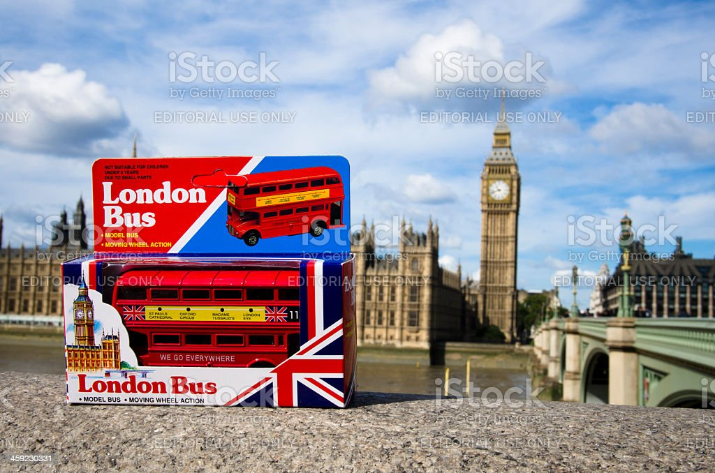London Bus toy with Big Ben Tower in background royalty-free stock photo