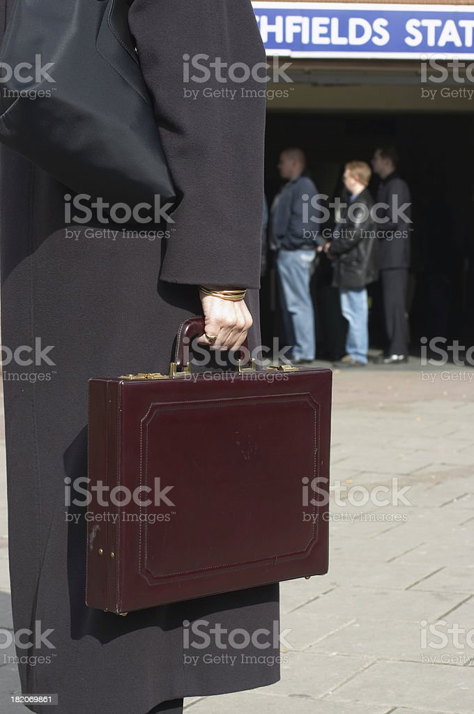 Business lady / brief case approaching underground station stock photo