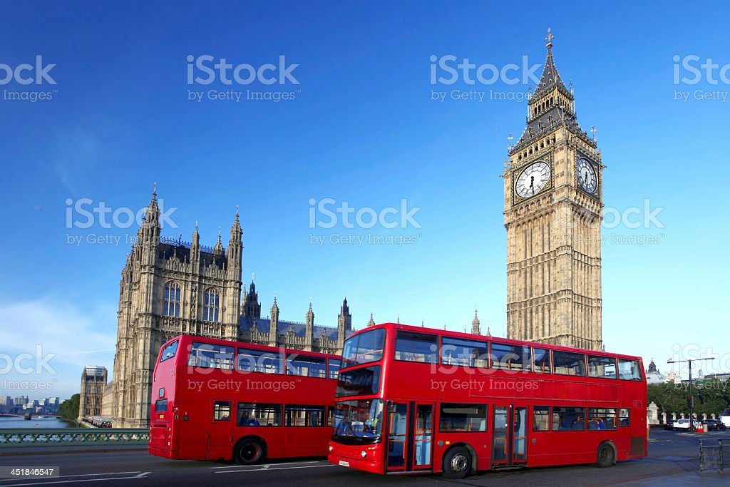 London busses in front of Westminster and Big Ben stock photo