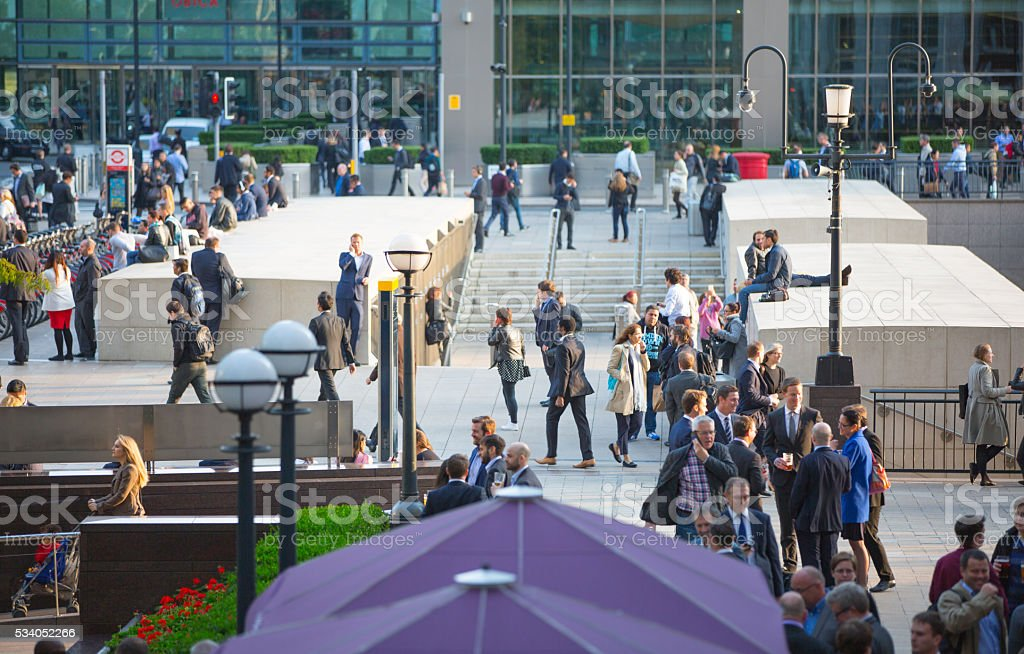 London, Canary wharf square with walking people stock photo