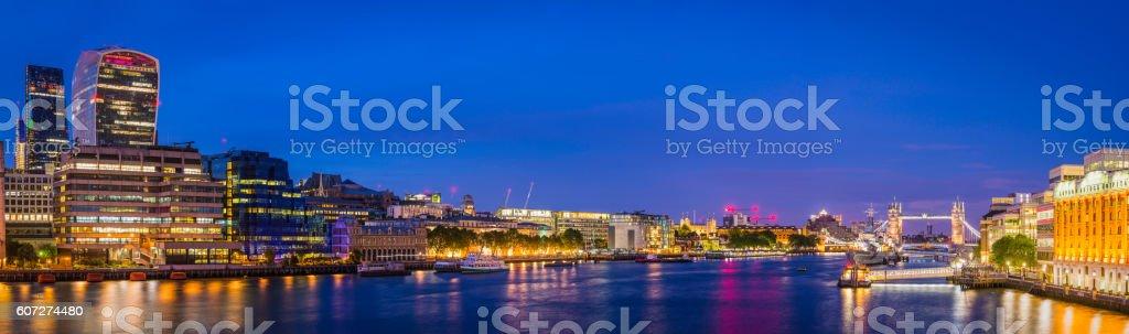 London City skyscrapers Tower Bridge Embankment lamplight reflecting Thames panorama stock photo