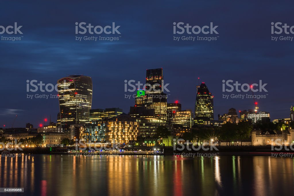 London cityscape at dusk along river Thames stock photo