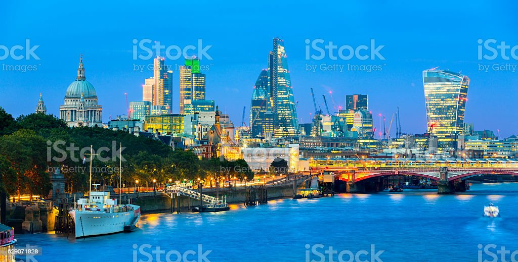 London cityscape at dusk with urban buildings over Thames River stock photo