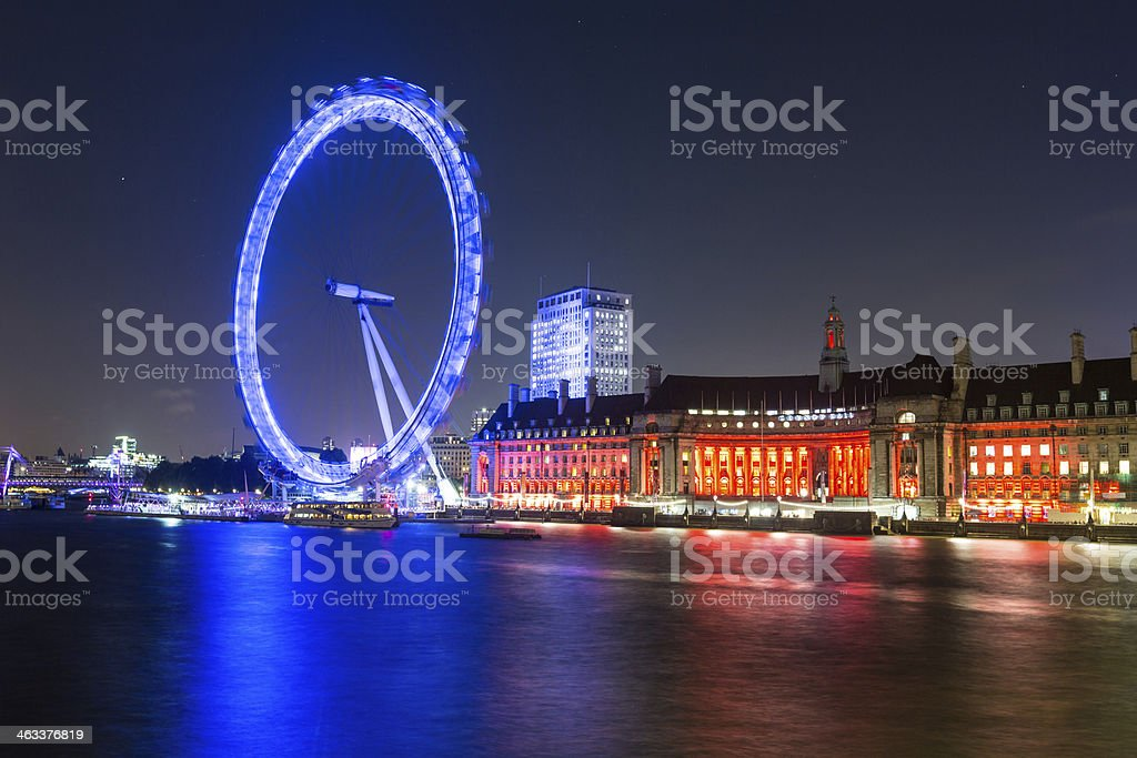 London Cityscape with Millennium Wheel at Night stock photo