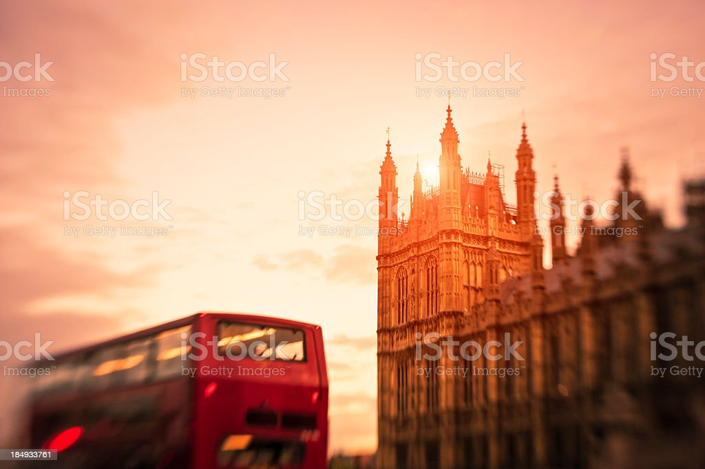 London Double Decker Bus Against Houses Of Parliament, Sunset royalty-free stock photo