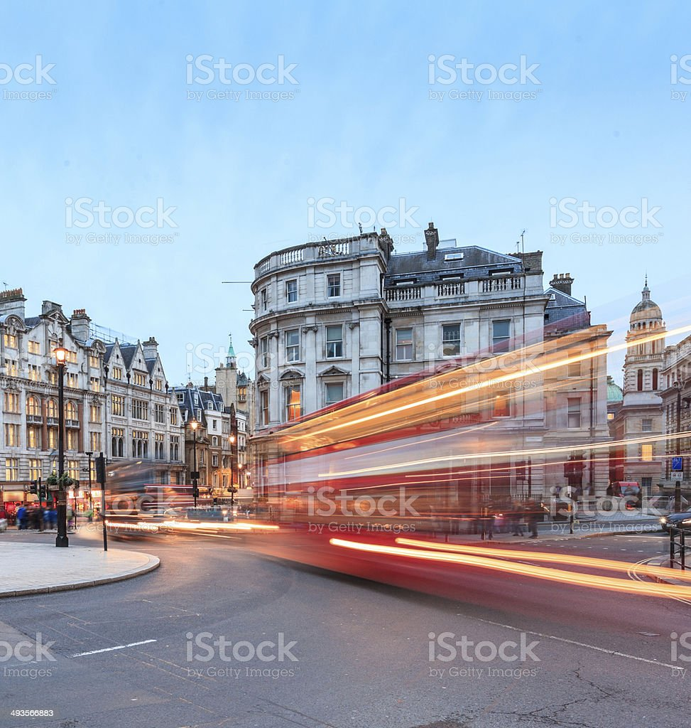 London, double-decker buses passing at Charing Cross junction stock photo