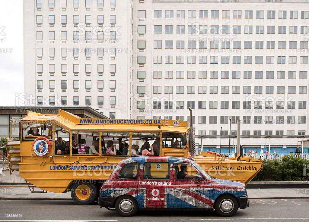 London duck boat tour bus and vodafone union jack taxi royalty-free stock photo