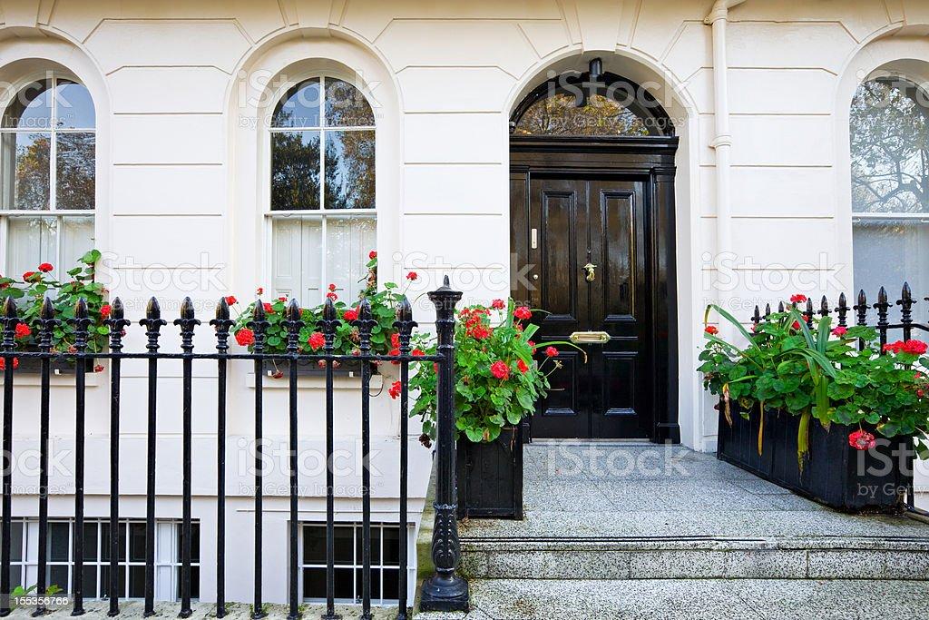 London England Typical White Stucco Georgian Style Row House Belgravia stock photo