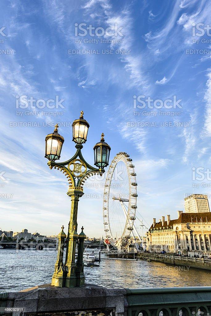 London Eye along the Thames river bank stock photo