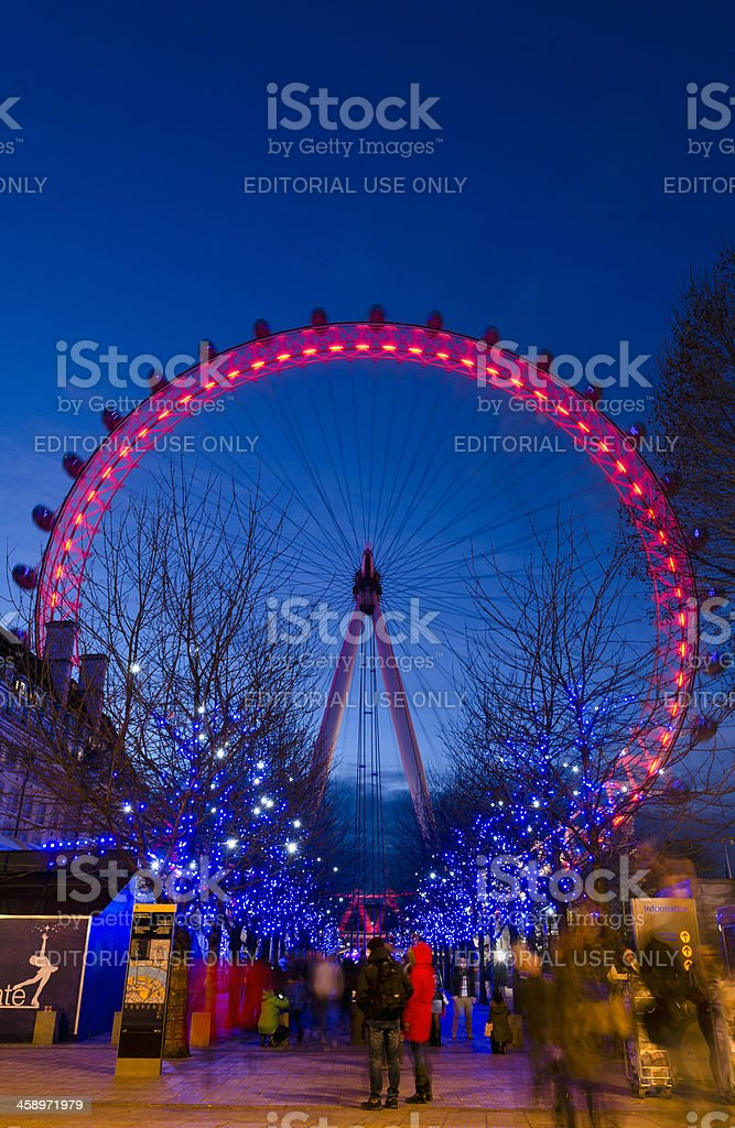 London Eye and Christmas lights at night, Thames South Bank royalty-free stock photo