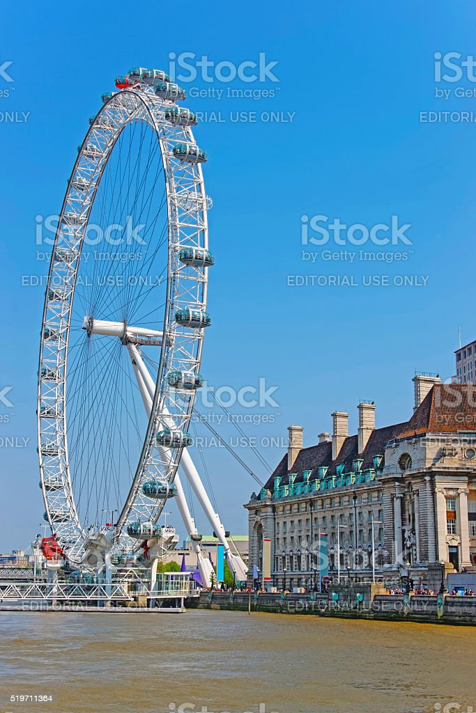 London Eye and County Hall near River Thames in London stock photo