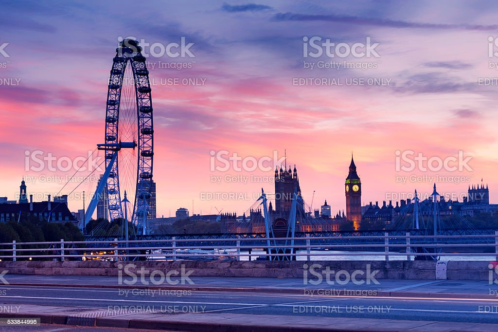 London Eye and The Houses of Parliament at sunset. stock photo