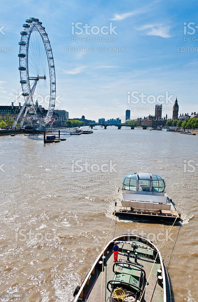 London Eye capsule floating down River Thames royalty-free stock photo