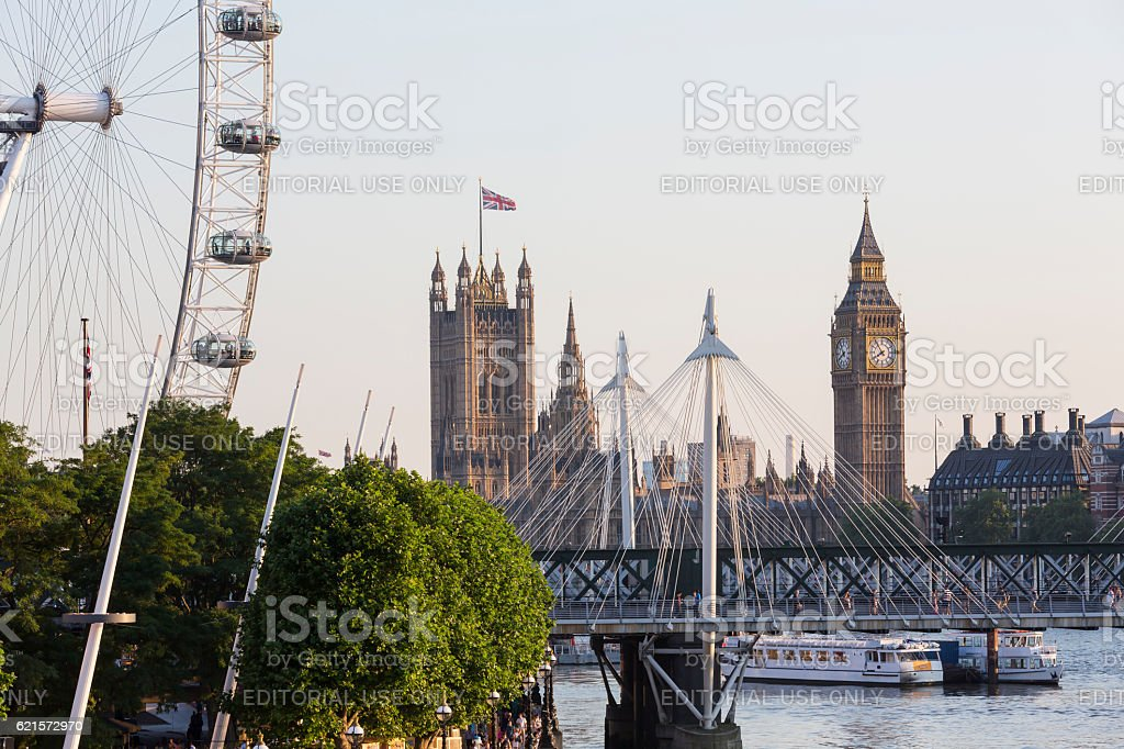 London Eye, Hungerford Bridge and Big Ben at sunset stock photo
