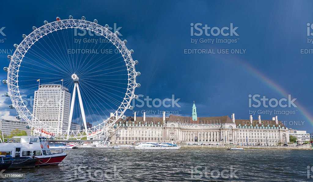 London Eye on stormy day with the rainbow royalty-free stock photo