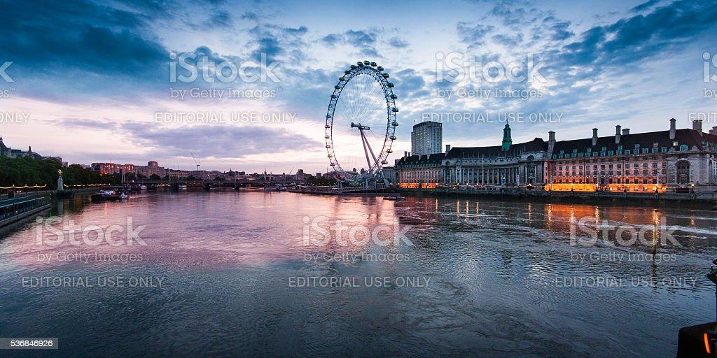 London Eye sunrise from Westminster Bridge stock photo
