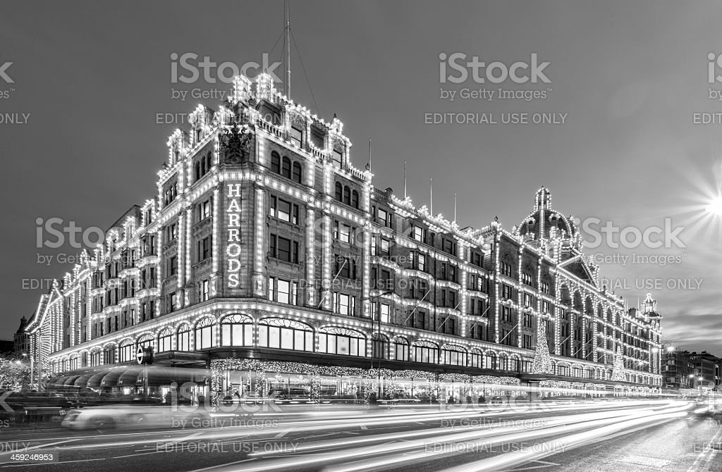 London, Harrods department stores at night in black & white royalty-free stock photo