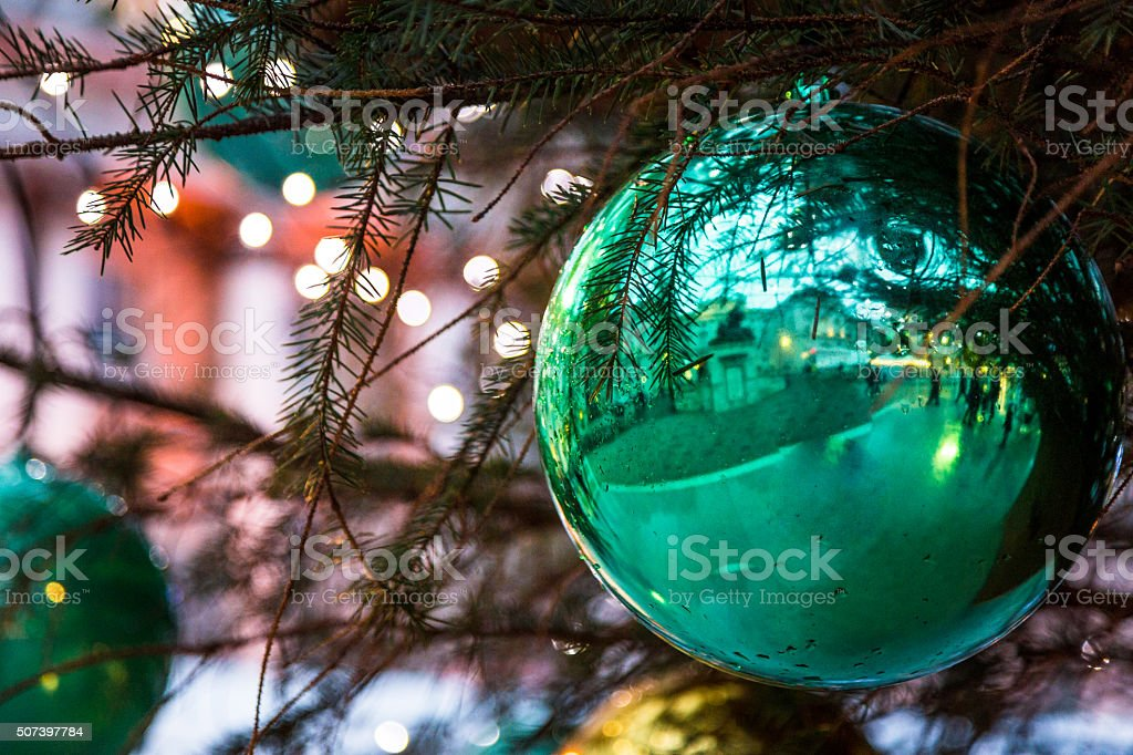 London Ice Skating Rink Reflected in a Green Christmas Bauble stock photo