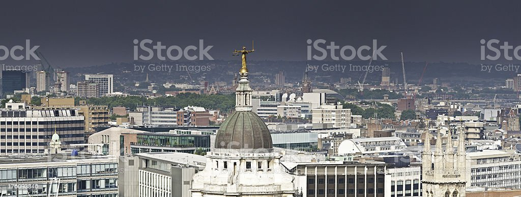 London Lady Justic Old Bailey watching over city panorama stock photo