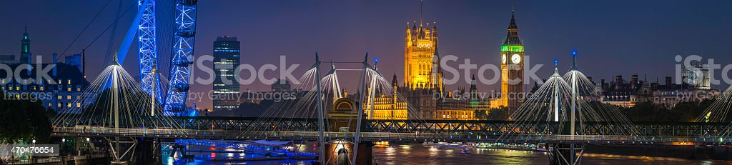 London landmarks illuminated night London Eye Big Ben Thames panorama stock photo