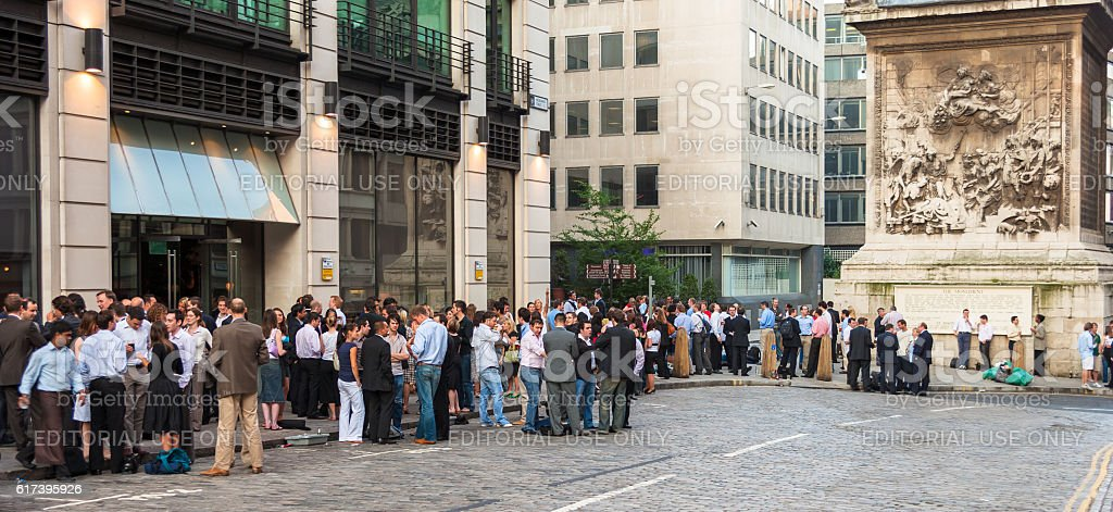 London pub with lots of people drinking after work. London, UK stock photo