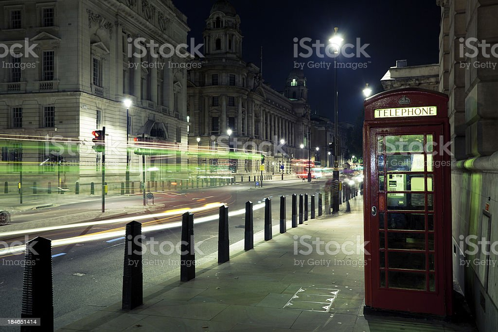 London Red Phone Booth at Night and Traffic royalty-free stock photo