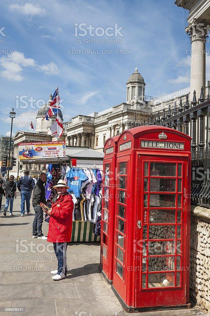 London red phone boxes beside Trafalgar Square UK royalty-free stock photo