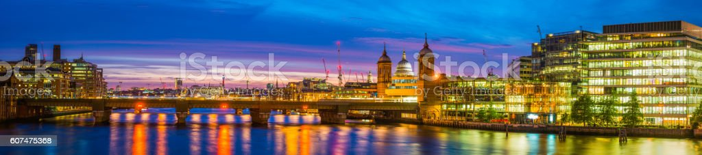 London River Thames reflecting office buildings spires sunset panorama stock photo