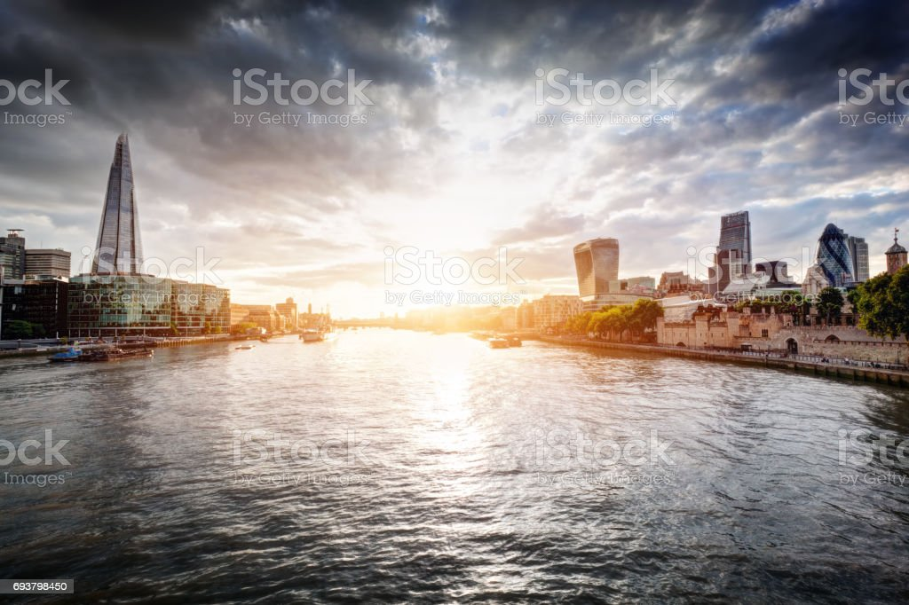 London skyline at sunset, England the UK. River Thames, the Shard, City Hall. stock photo