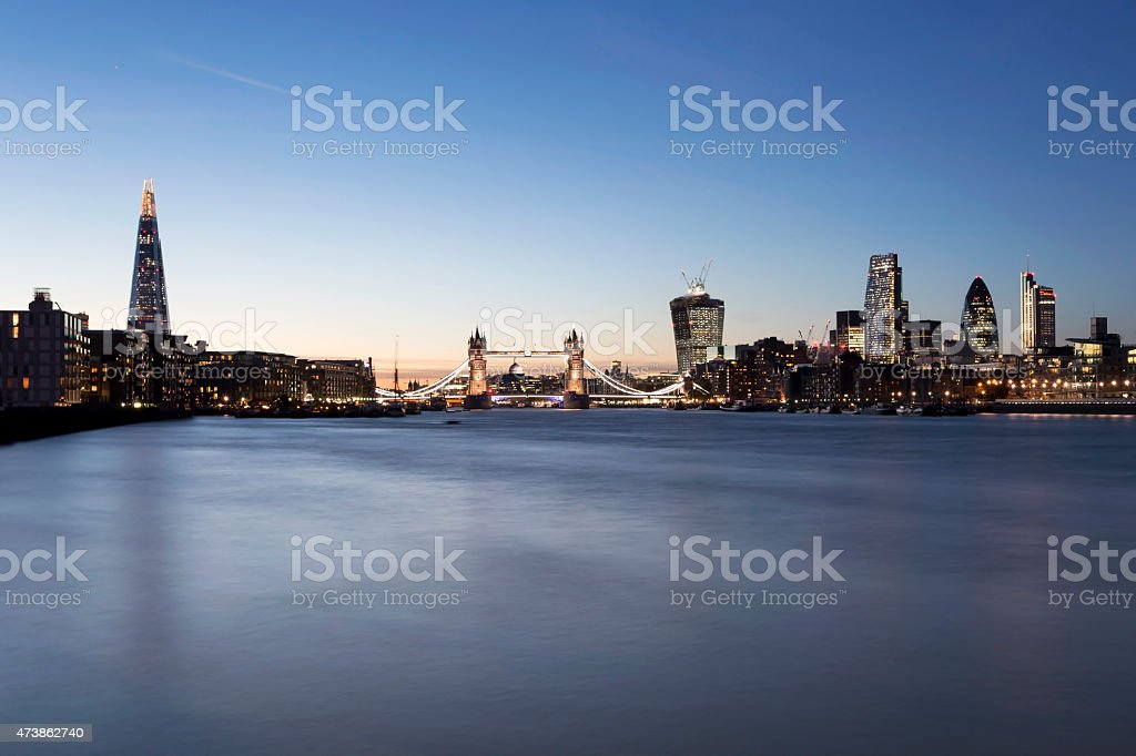 London skyline The Shard Tower Bridge City of London dusk stock photo
