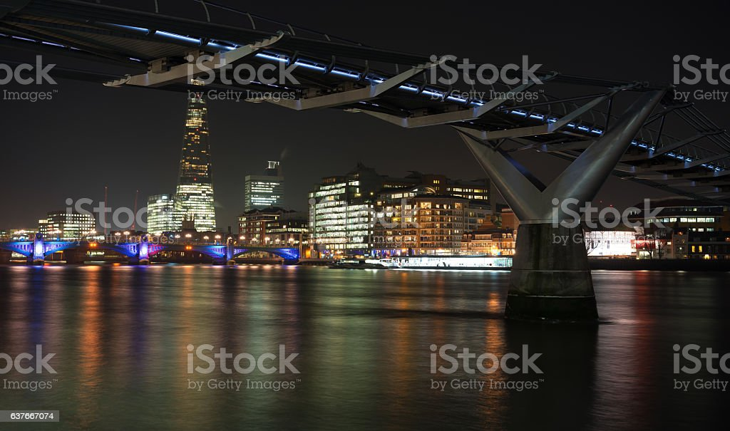 London south bank skyline and River Thames at night stock photo