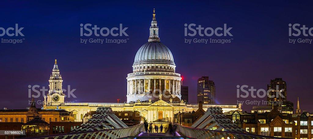 London St Pauls Cathedral illuminated at night overlooking Millenium Bridge stock photo