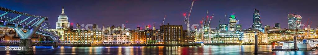 London St Pauls Cathedral Millenium Bridge City skyscrapers overlooking Thames stock photo