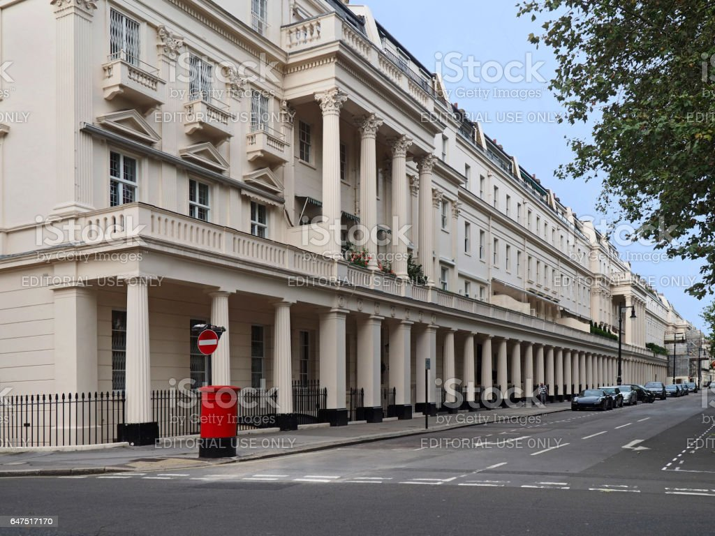 London street with long row of townhouses with columns stock photo