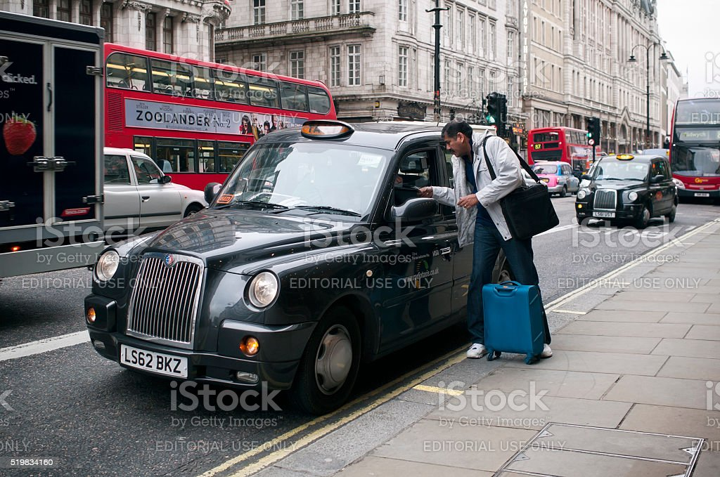 London taxi cab and a passenger stock photo